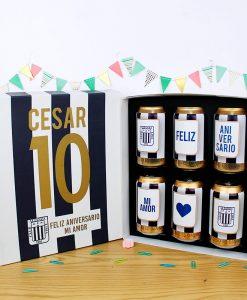 caja de 6 latas de cerveza pilsen con diseño del equipo de alianza lima